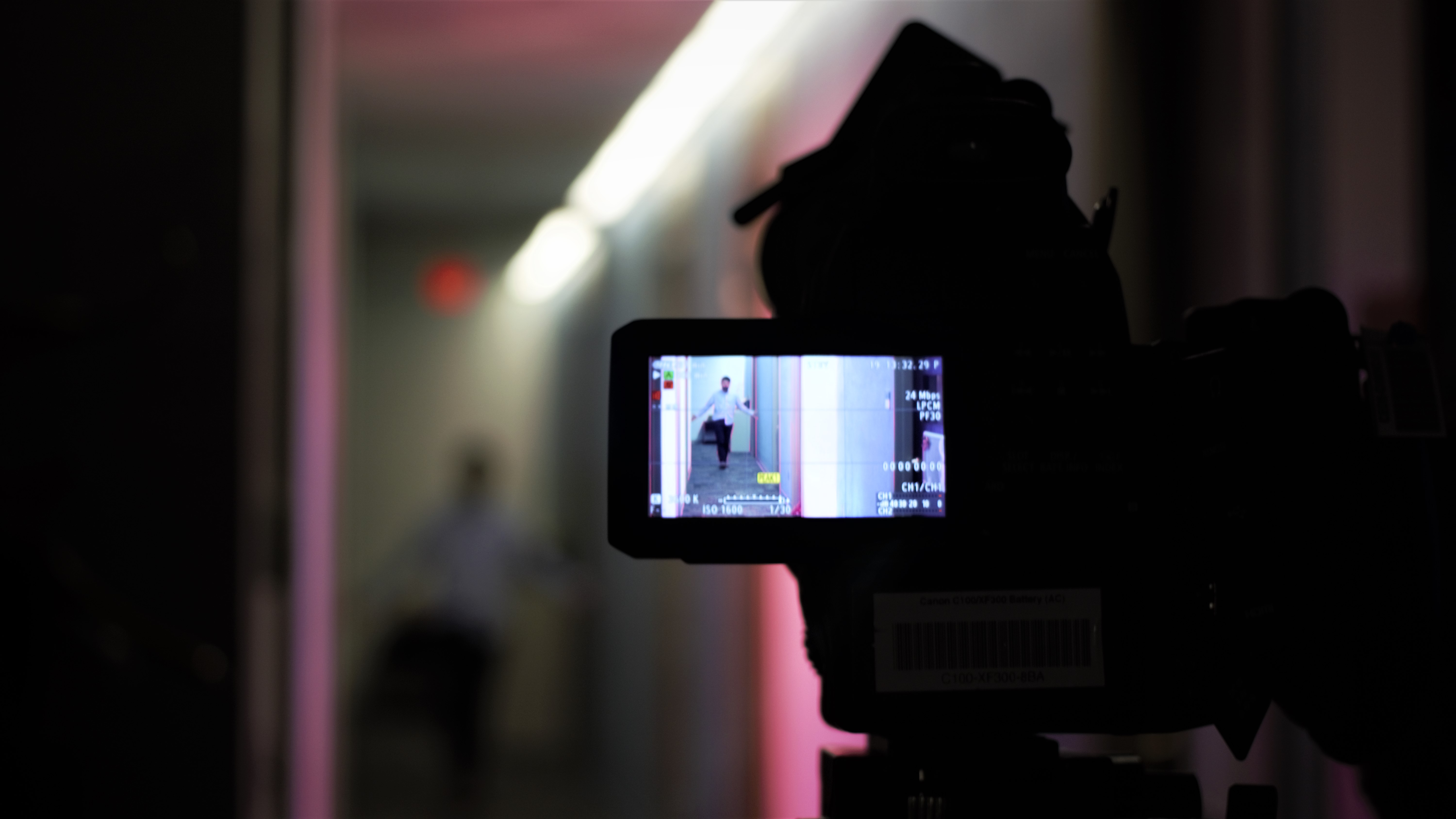 camera recording a scene of person in hallway